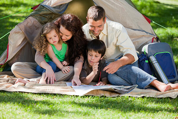 Joyful family camping
