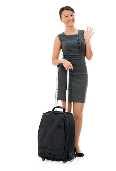 Successful business woman travelling - isolated over white background
